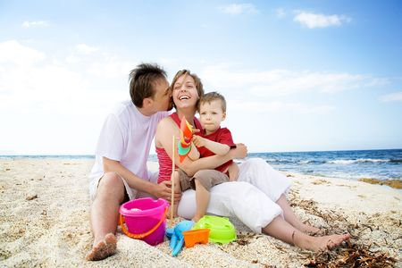 Happy family having fun on the beach. photo
