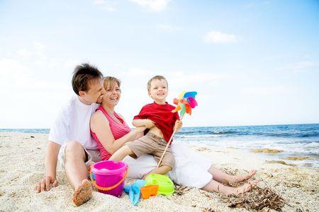 Happy family having fun on the beach. photo