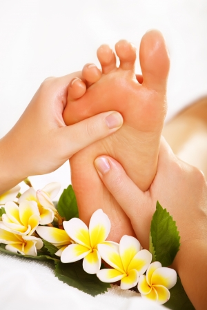 Exotic foot massage and spa foot treatment. photo