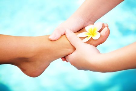color therapy: Exotic foot massage and spa foot treatment.