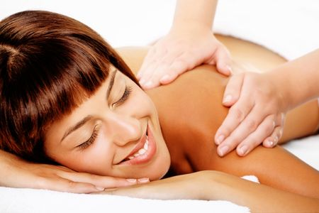 Close-up of a beautiful smiling woman getting a massage. photo