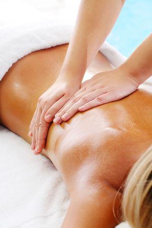 beauty therapist: Massage Techniques I - woman receiving professional massage. Stock Photo