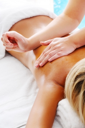therapists: Massage Techniques V - woman receiving professional massage. Stock Photo