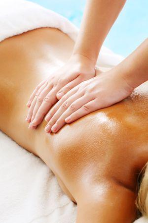 back massage: Massage Techniques IV - woman receiving professional massage.