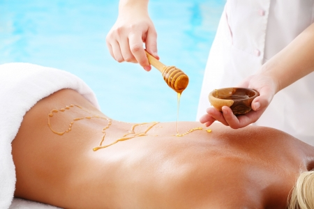 massage herbal: Spa Treatment - woman undergoing  spa treatment with honey.
