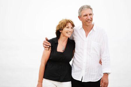 Beautiful mature couple taking a romantic walk photo