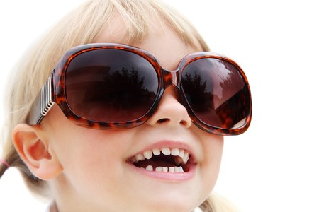 Cute little girl wearing sunglasses. Isolated on white. photo