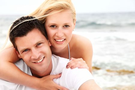 Happy couple on the beach. Shallow DoF with focus on the man. photo