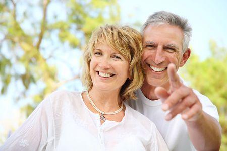 Close-up portrait of a mature couple smiling. photo