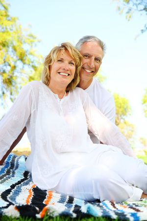Mature couple smiling. Focus on the woman.