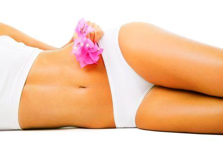 Beautiful slim female body. Isolated over white background. photo