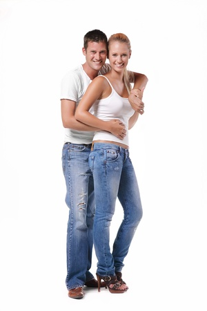 Happy young couple. Isolated over white background. Banque d'images