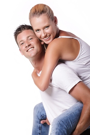 Happy young couple. Isolated over white background. photo