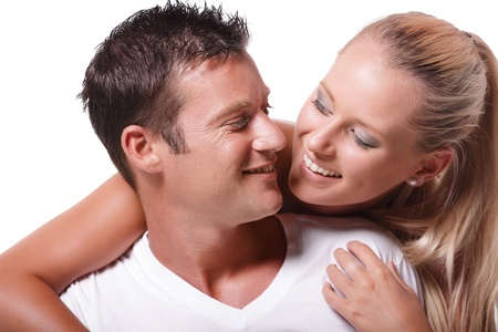 Happy young couple. Isolated over white background. Stock Photo