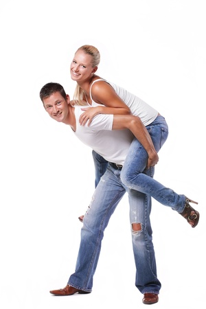 Happy young couple. Isolated over white background. Stock Photo - 8453556