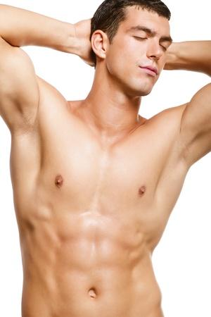 En santé musculaire jeune homme. Isolé sur fond blanc.