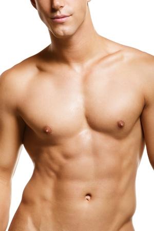 desnudo masculino: Joven muscular sano. Aislados sobre fondo blanco.