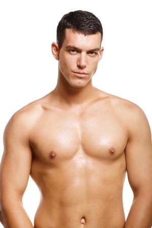 modelos desnudas: Joven muscular sano. Aislados sobre fondo blanco.