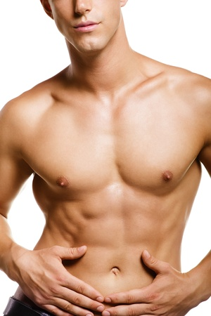 nudo maschile: Giovane muscolare sano. Isolato su sfondo bianco.