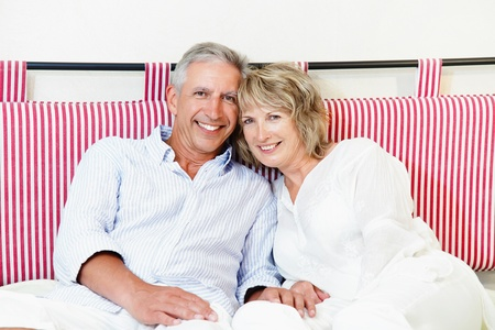 Happy mature couple at home Standard-Bild