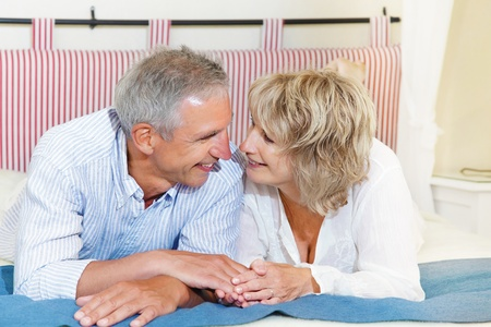 new ages: Happy mature couple at home Stock Photo