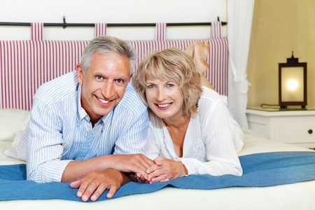 Happy mature couple at home Stock Photo