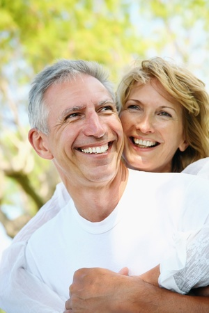 Mature couple smiling and embracing Stock Photo - 9152676