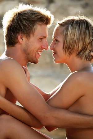 Young hot couple in love on the beach photo
