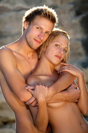 hot sexy girls: Young hot couple in love on the beach Stock Photo