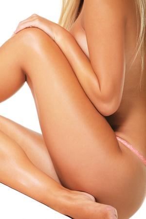 Beautiful female body isolated over white background photo