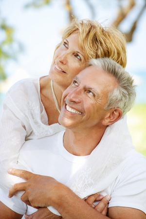 Portrait of a happy mature couple outdoors photo
