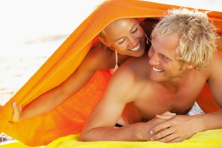 Happy young couple on the beach Stock Photo - 12669085