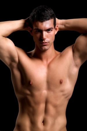Healthy muscular young man  Isolated on black background   Shallow DoF with focus on face  photo