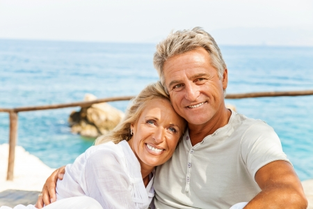 happy senior couple: Mature couple smiling and embracing