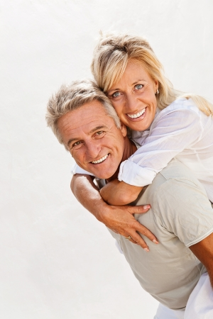 male senior adult: Mature couple smiling and embracing
