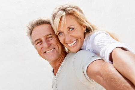 good looking man: Mature couple smiling and embracing