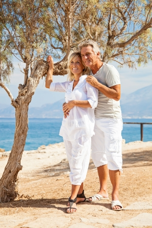 Mature couple smiling and embracing Stock Photo - 19245327