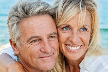 Mature couple smiling and embracing photo