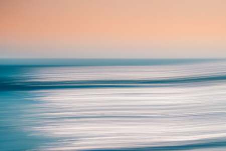 Abstract seascape. An abstract ocean seascape with blurred panning motion. Image displays a blue and light pink split-toned color scheme.