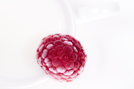 Cup of Milk and Raspberry on white, top view