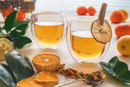 Cups of Tea with Mint and Citrus. Lime, Oranges and Tangerines