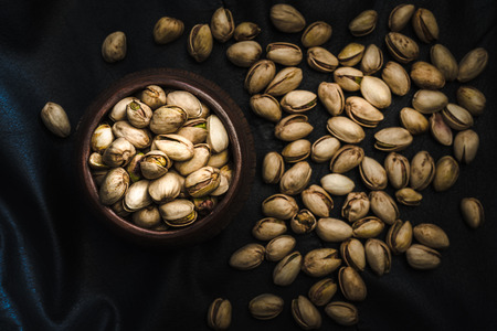 Pistachios, black  background, view  from the above, close up Stock Photo