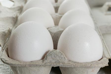 Farm Fresh White Eggs in Carton Box on White, Close up 스톡 콘텐츠