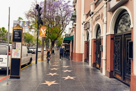 Hollywood Walk of Fame at Morning. Hollywood, Los Angeles with tourists walking on the stars. Los Angeles, Hollywood, California, USA, May 14, 2019 Editorial