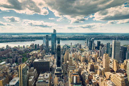 New York City Skyline Aerial View. Hudson River and East River, Ocean and Cloudy Blue Sky on a Horizon