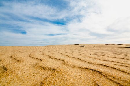 Sand Dunes and Beautiful Cloudy Blue Sky