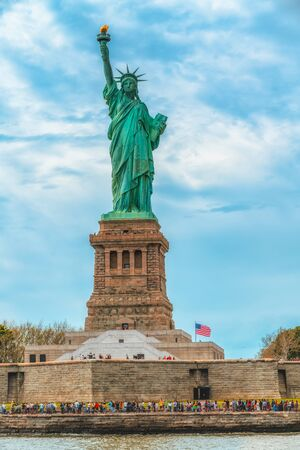 Statue of Liberty on Liberty Island, New York City. Cloudy Blue Sky Background, Vertical Banner