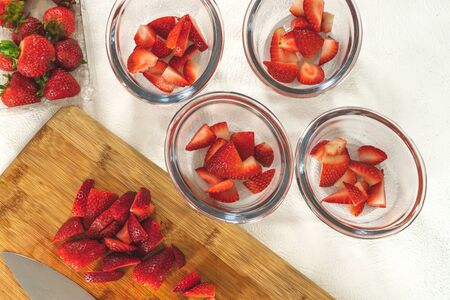 Sliced Fresh Ripe Strawberries on a Chopping Board Ready to be Served