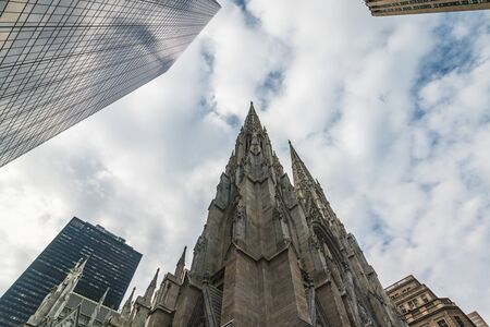 New York City Fifth Avenue St. Patricks Cathedral Against Cloudy Blue Sky