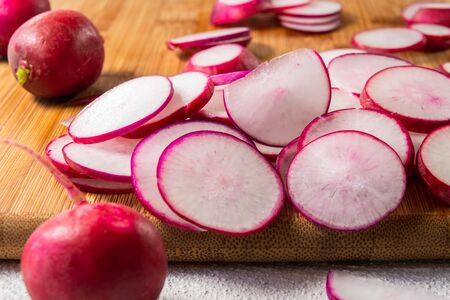 Radish Sliced on a Wooden Chopping Board Close Up